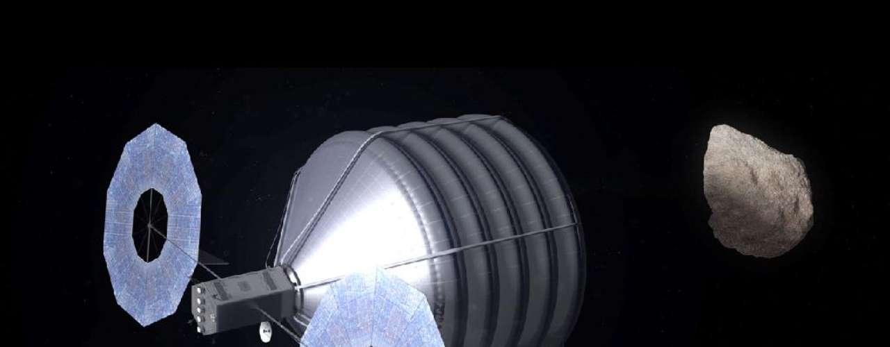 A ilustração de uma nave robô que deve ser utilizada no futuro para capturar um asteroide foi apresentada pela Nasa neste ano. O orçamento da agência espacial americana em 2014 inclui um plano para capturar um pequeno asteroide próximo à Terra e rebocá-lo até a Lua.-