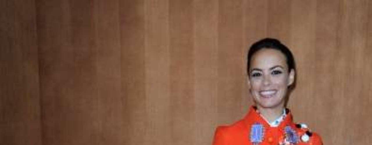 A atriz francesa Bérénice Bejo, que mais cedo havia estado no desfile da Louis Vuitton, também foi ao desfile da Miu Miu