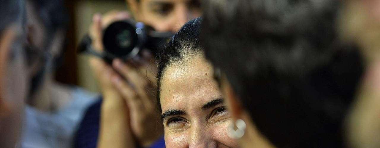 Blogueira cubana sorri durante o evento realizado no Estadão