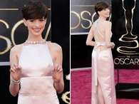 Decote nas costas do vestido de Anne Hathaway Foto: Getty Images