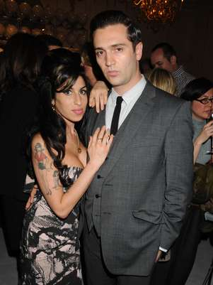 Reg Traviss, Amy Winehouse Foto: Getty Images