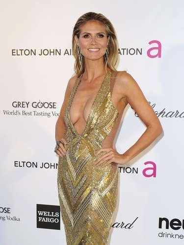 As festas Vanity Fair Oscar e Elton John AIDS Foundationreceberamum time de celebridades após a 85ª premiação da Academia,na noite de domingo (24), em Hollywood, na Califórnia (EUA). Na foto, a modeloHeidi Klum exibe um decote ousado