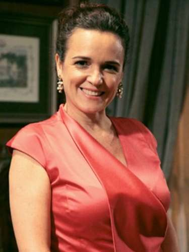 Neide (Sandra Corveloni)  Esposa de Amadeu. Neide é muito passional, dedicadíssima ao marido e aos filhos