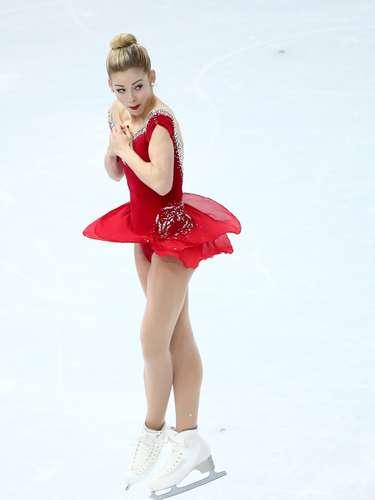 O coque alto foi a opção da atleta Gracie Gold, dos Estados Unidos, na prova de patinação