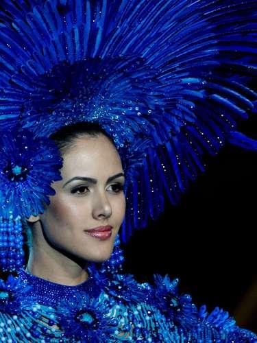 No início desta sexta-feira (27), as 27 candidatas ao título de Miss Brasil 2013 participaram de um momento muito tradicional nos concursos de beleza: o desfile de trajes típicos. O evento aconteceu no Minas Centro, em Belo Horizonte, e contou com as torcidas de cada estado.Na foto, a Miss Goiás