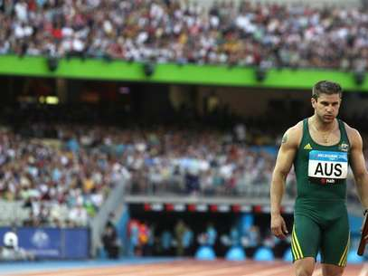 Australia's Daniel Batman competes in the men's 4x100 relay final at the Commonwealth Games in Melbourne March 25, 2006. Foto: Luis Enrique Ascui / Reuters In English