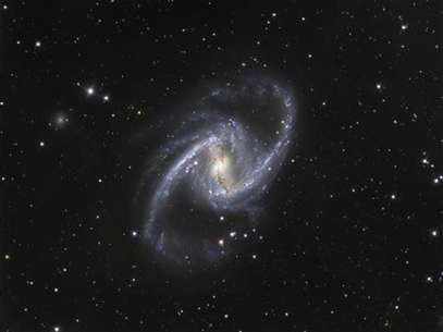 The NGC 1365 galaxy, also known as the Great Barred Spiral Galaxy, is seen in an image that combines observations performed through three different filters with the 1.5-metre Danish telescope at the European Southern Observatory (ESO) in Chile, in this handout photo distributed on September 22, 2010. Foto: Handout / Reuters In English
