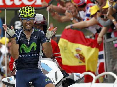 Movistar Team rider Alejandro Valverde of Spain celebrates winning the 17th stage of the 99th Tour de France cycling race between Bagneres-de-Luchon and Peyragudes, July 19, 2012.             REUTERS/Stephane Mahe (FRANCE - Tags: SPORT CYCLING) Foto: STEPHANE MAHE / REUTERS