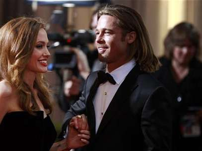 Actress and presenter Angelina Jolie and her partner actor Brad Pitt arrive at the 84th Academy Awards in Hollywood, California, February 26, 2012. Foto: Lucas Jackson / Reuters In English