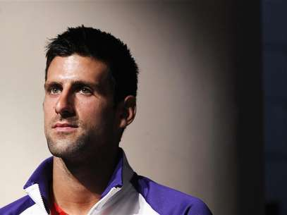 2011 US Open champion Novak Djokovic of Serbia listens to speakers during the US Open tournament draw ceremony at the Billie Jean King National Tennis Center in New York August 23, 2012. Foto: Lucas Jackson / Reuters In English