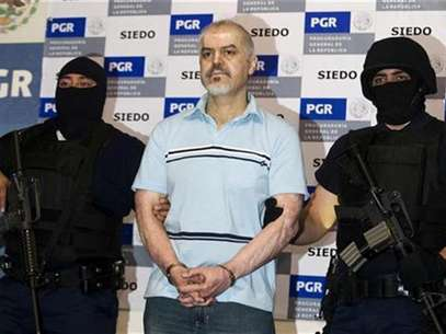 Drug cartel leader Eduardo Arellano Felix is presented to the media in Mexico City, October 27, 2008. Foto: Jorge Dan Lopez / Reuters In English