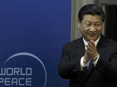 Chinese Vice President Xi Jinping arrives for the opening ceremony of the World Peace Forum held in Beijing in this July 7, 2012 file photo. Foto: Files / Reuters In English