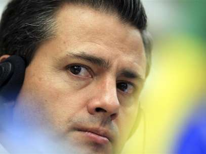 Mexico's President-elect Enrique Pena Nieto attends a media conference after a business meeting at the FIESP (Sao Paulo Industry Federation) in Sao Paulo September 19, 2012. Foto: Paulo Whitaker / Reuters In English