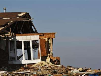 The debris of a home damaged by Superstorm Sandy is seen one month after the disaster at the zone of Union Beach in New Jersey November 29, 2012. Foto: Eduardo Munoz / Reuters