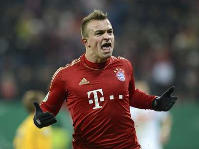 Bayern Munich's Swiss midfielder Xherdan Shaqiri celebrates after scoring the second goal for Munich during the German Cup football match FC Augsburg vs FC Bayern Munich in Augsburg, southern Germany, on December 18, 2012. Foto: Getty Images