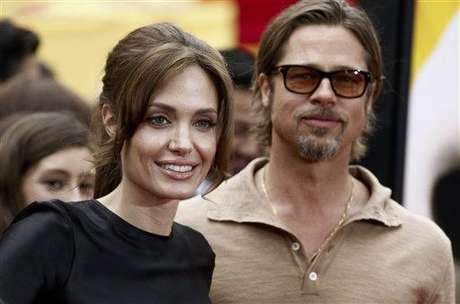 "Cast member Angelina Jolie, left, and Brad Pitt arrive at the premiere of ""Kung Fu Panda 2"" in Los Angeles, Sunday, May 22, 2011.  The film opens May 26, 2011. (AP Photo/Matt Sayles)"