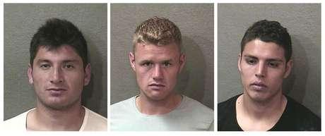 Esta serie de fotos proporcionada por la policía de Houston muestra de izquierda a derecha a los jugadores de Toronto, Miguel Aceval, Nick Soolsma y Luis Silva, acusados de embriagarse en la vía pública la madrugada del lunes 18 de junio de 2012