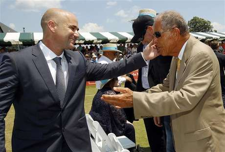Andre Agassi (L) hugs coach Nick Bollettieri after Agassi was inducted into the International Tennis Hall of Fame in Newport, Rhode Island July 9, 2011.