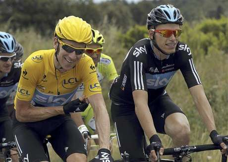 Sky Procycling rider and holding the leader's yellow jersey Bradley Wiggins of Britain (L) rides with his team mate Christian Knees of Germany during the 13th stage of the 99th Tour de France cycling race between Saint-Paul-Trois-Chateaux and Cap d'Agde, July 14, 2012.