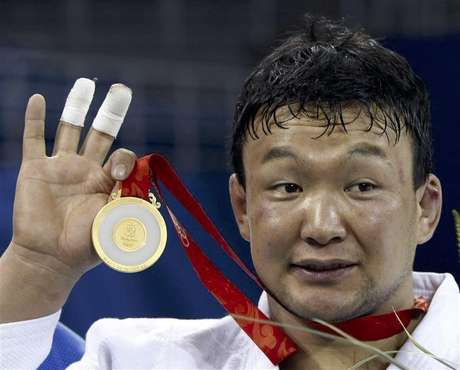 Gold medallist Tuvshinbayar Naidan of Mongolia holds his medal during the medal ceremony of the men's -100kg judo event at the Beijing 2008 Olympic Games, in this August 14, 2008 file photo.