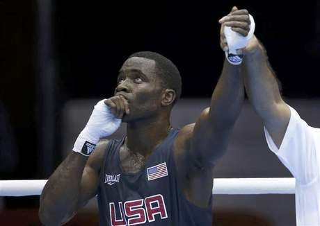 Terrell Gausha of the U.S. reacts after defeating Armenia's Andranik Hakobyan in the Men's Middle (75kg) Round of 32 Bout 8 boxing match at ExCeL venue during the London 2012 Olympic Games July 28, 2012.