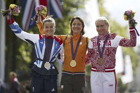 Gold medallist Marianne Vos of the Netherlands (C), silver medallist Elizabeth Armitstead of Britain (L) and bronze medallist Olga Zabelinskaya of Russia stand on the podium during the victory ceremony for the women's cycling road race at the London 2012 Olympic Games July 29, 2012.
