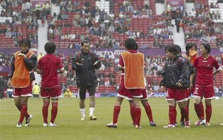 Members of the North Korea team warm up before their women's football first round Group G match against the U.S. at Old Trafford in Manchester during the London 2012 Olympic Games July 31, 2012.