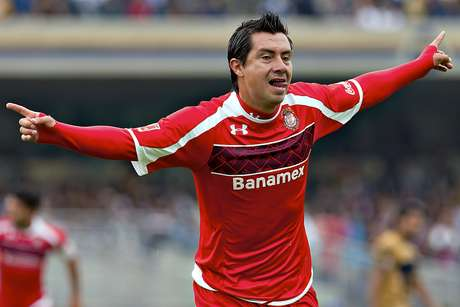 Toluca's Luis Cacho celebrates after opening up the score against Pumas in the first half.