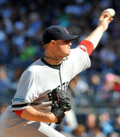 John Lester powered the Red Sox past rival Yankees.