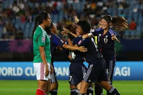 Japan celebrates a goal in its 4-1 win over Mexico in the U-20 women's World Cup.
