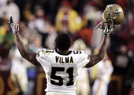 New Orleans Saints linebacker Jonathan Vilma celebrates the Saints' overtime win against the Washington Redskins in Landover, Maryland December 6, 2009.