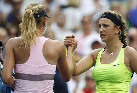 Azarenka (R) is congratulated by Sharapova after winning 3-6, 6-2, 6-4. REUTERS/Adam Hunger