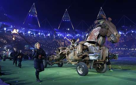 Performers march with a horse-like vehicle called the Human Endeavour machine in the Olympic Stadium, during the closing ceremony of the London 2012 Paralympic Games September 9, 2012.   REUTERS/Suzanne Plunkett (BRITAIN - Tags: SPORT OLYMPICS)
