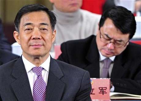 China's former Chongqing Municipality Communist Party Secretary Bo Xilai (L) and former Deputy Mayor of Chongqing Wang Lijun (R) attend a session of the Chinese People's Political Consultative Conference (CPPCC) of the Chongqing Municipal Committee, in Chongqing municipality, January 7, 2012.