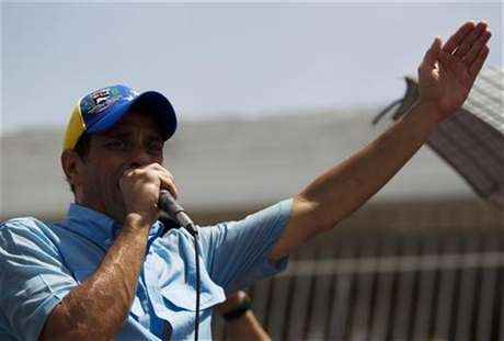 Venezuelan opposition candidate Henrique Capriles talks to supporters during an election rally in the state of Carabobo, some 180km (112 miles) west of Caracas, August 17, 2012.