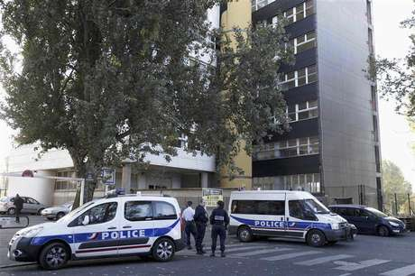 French police cars are parked in front of satirical weekly Charlie Hebdo offices in Paris September 19, 2012. Charlie Hebdo published cartoons of the Prophet Mohammad on Wednesday, a decision criticised by the French authorities which sent riot police to protect the magazine's offices.