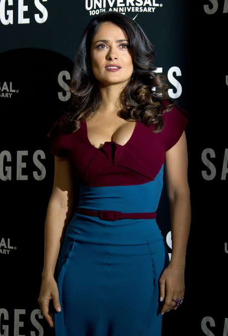 Salma Hayek was particularly perky in London. The sexy actress wore a tight dual-toned dress that made her cleavage pop out.