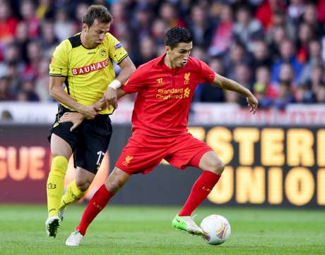 Liverpool's Nuri Sahin gets past Young Boys' defender Elsad Zverotic in a thrilling Europa League game that ended 5-3.