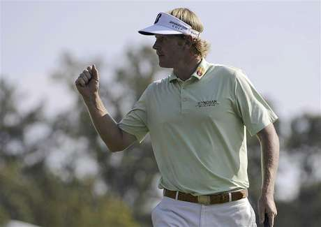 Brandt Snedeker of the U.S. reacts to a birdie on the 17th hole to go 8-under par during the third round of the Tour Championship golf tournament at the East Lake Golf Club in Atlanta, Georgia September 22, 2012.