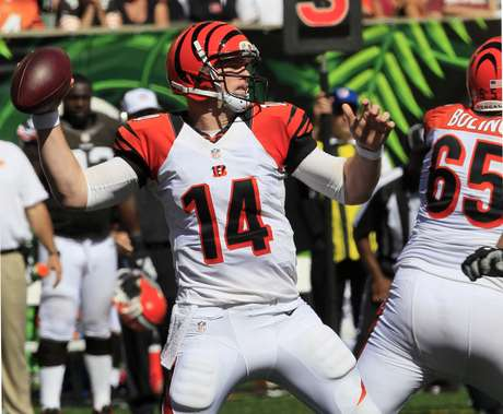 Cincinnati Bengals quarterback Andy Dalton (14) passes against the Cleveland Browns in the second half of an NFL football game on Sunday, Sept. 16, 2012, in Cincinnati.