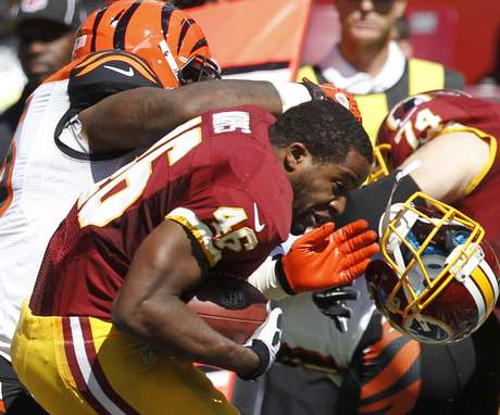 Washington Redskins running back Alfred Morris loses his helmet during a tackle in the first half of their NFL football game against the Cincinnati Bengals in Landover, Maryland, September 23, 2012.