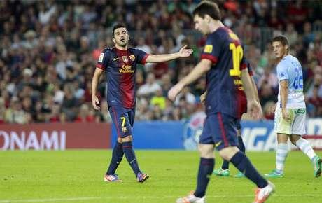 A Villa no le gustó que Leo le hiciera esos gestos y no dudó en responderle. En la segunda mita, Villa fue sustituido por Xavi.