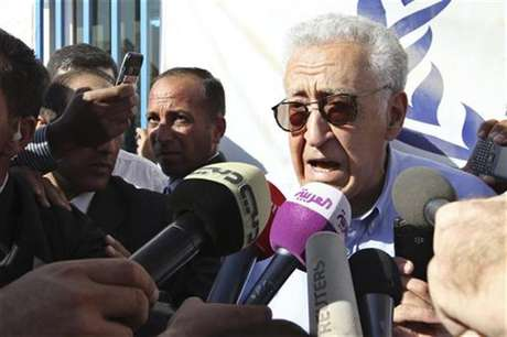 UN-Arab League peace envoy for Syria Lakhdar Brahimi speaks to the media during his visit to the Al Zaatri refugee camp in the Jordanian city of Mafraq, near the border with Syria, September 18, 2012.