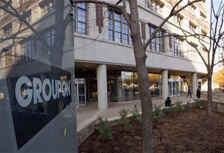 People enter and leave Groupon Inc corporate office and headquarters in Chicago, Illinois, November 4, 2011.