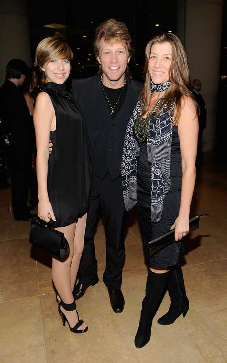 Jon Bon Jovi (center) poses with daughter Stephanie Rose Bongiovi (left) and his wife Dorothea Rose Hurley (right) at a 2010 Grammy Awards event in Beverly Hills, California.