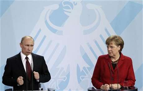 German Chancellor Angela Merkel and Russian President Vladimir Putin address the media after talks in Berlin, June 1, 2012.