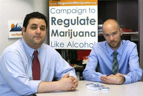 Mason Tvert (L) and Brian Vicente pose in their offices in Denver, Colorado, May 25, 2012. The two are the leaders of a campaign calling for the legalization of an ounce of marijuana, and creating a legal framework so the drug's sale could be regulated and taxed by the state as alcohol is today.