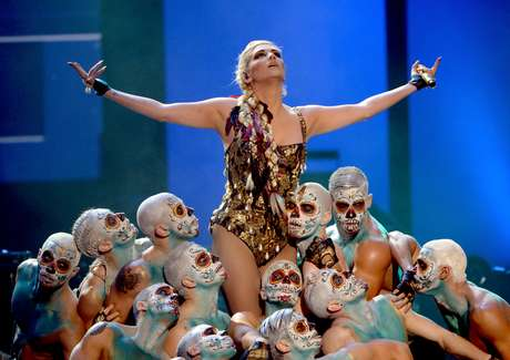 """Best: Ke$ha and her sexy cult of hot men killed it adding a fantastic drum break during her """"Die Young"""" performance."""