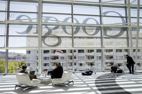 Attendees sits in front of a Google logo during Google I/O Conference at Moscone Center in San Francisco, California June 28, 2012.