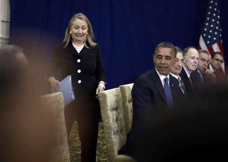 U.S. Secretary of State Hillary Clinton reacts as she arrives last for a meeting between President Barack Obama and Japan's Prime Minister Yoshihiko Noda at the East Asia Summit in Phnom Penh, November 20, 2012.